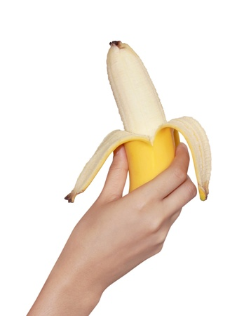 bannana: bannana in woman hands isolated on white background