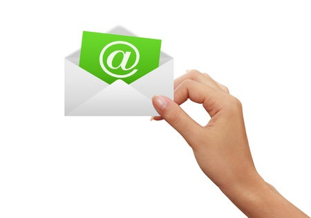 email communication: Envelope and e-mail in the hands of women Stock Photo