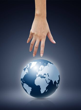 Women hand  pointing down to the globe photo