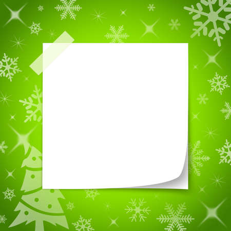 wish list: White paper notes with adhesive tape placed on the surface of a green Christmas