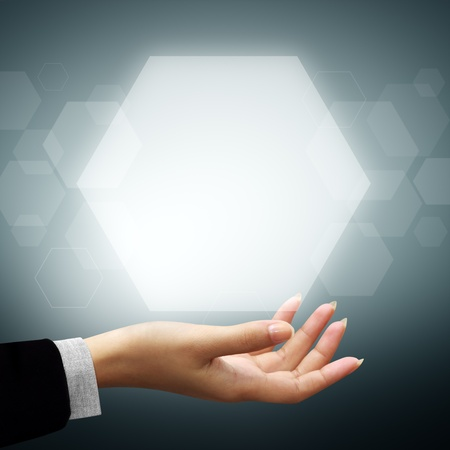 Hexagon touch screen interface on woman hand photo