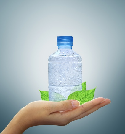 leaf water drop: bottle water mineral and leaf in hand