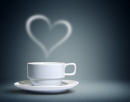 caffeine: Coffee cup with heart shaped white smoke