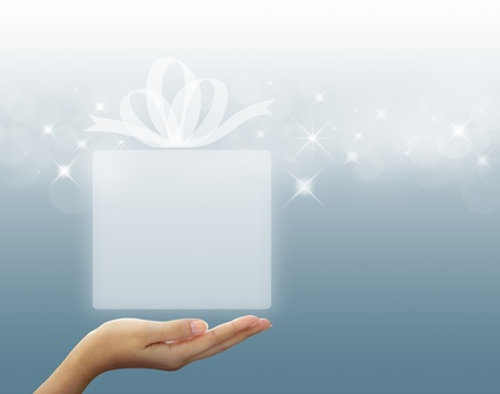 gift box Translucent white in hand Stock Photo