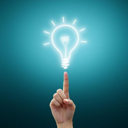 fingertip: Hand point to Light bulb idea on blue background