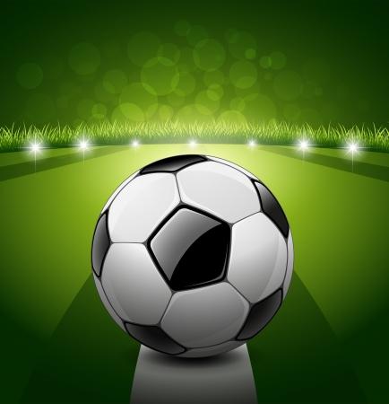 cancha de futbol: Bal�n de f�tbol en fondo de la hierba verde