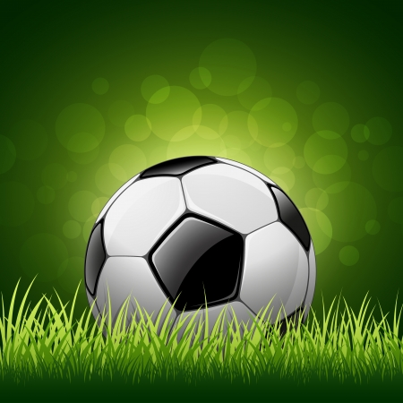 Soccer ball on grass background