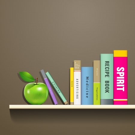 Row of colorful books and green apple on shelf