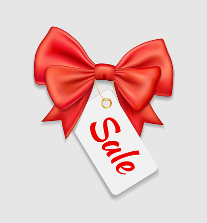 Red bow ribbon and tag sale isolated on white