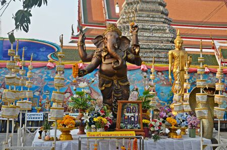 wat arun: statue of god ganesha and offerings in wat arun areal in bangkok, thailand Stock Photo
