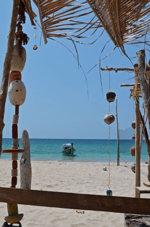 buoys: boat in the sea and decorations from shells and buoys
