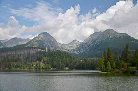 ski jump: view of the mountain lake Strbske pleso and ski jump in High Tatras in Slovakia Stock Photo