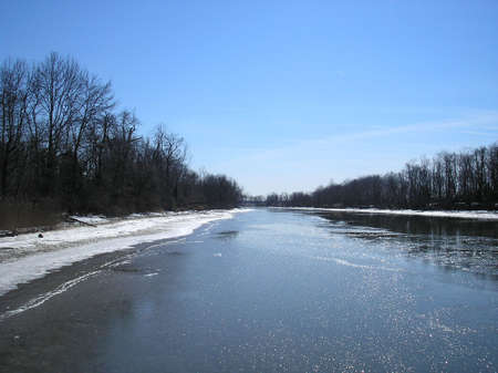 river bank: Partially frozen Gunpowder River, ice-covered river bank, and tree-lined river bank, Maryland (2007)