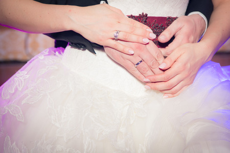 Wedding couple holding hands photo