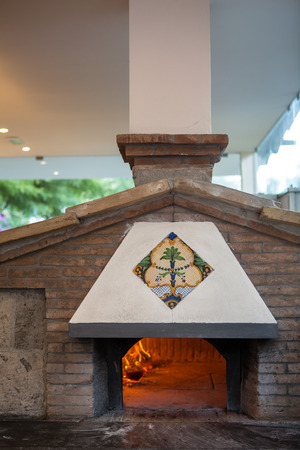 woodfire: A traditional oven for cooking and baking pizza.