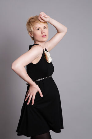 fashionable pregnant woman in black dress  studio shot photo