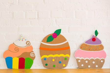colored cakes handmade ​​of paper on white background photo