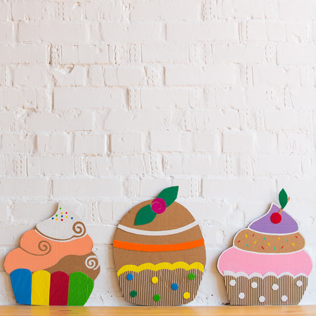 colored cakes handmade of paper on white background photo