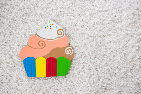 colored cake handmade of paper on white background photo