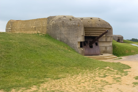 hoc: Old broken German bunkers of Atlantic Wall and artillery battery of Longues sur Mer. The battery at Longues was situated between the landing beaches Omaha and Gold, Normandy, France