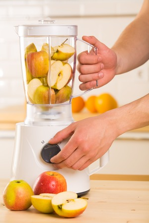 White blender with apples on a wooden table  Kitchen photo