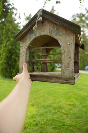 Wooden feeders for birds in the Park photo