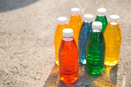 Color, bright creative background  Colored bottles on the pavement photo