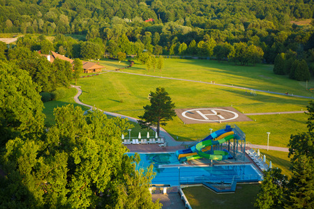 heliport: peak helipad and swimming pool under sunset