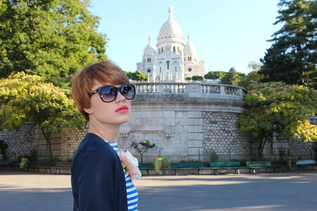 french ethnicity: Beautiful young woman of Sacre-Coeur Basilica in the Montmartre area in Paris, France. Stock Photo