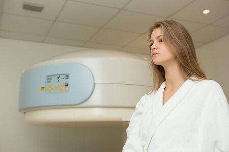 x ray machine: Happy woman undergoing open Magnetic resonance imaging scan.