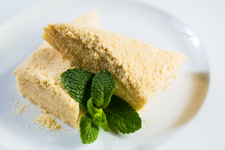 napoleon dessert: Cake Napoleon of puff pastry with sour cream on a plate. Tasty and nutritious dessert Stock Photo