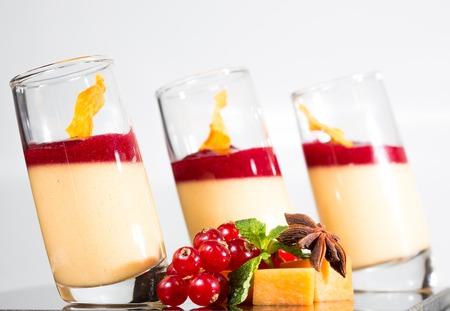 Dessert panna cotta with fresh berry on white background photo