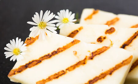 haloumi: Halloumi cheese frying in grill pan. Closeup