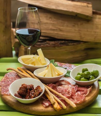 antipasti: different italian antipasti and red wine. selective focus Stock Photo