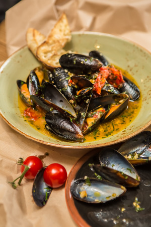 wine sauce: Moules Marinieres. Mussels cooked with white wine sauce. Shallow dof.