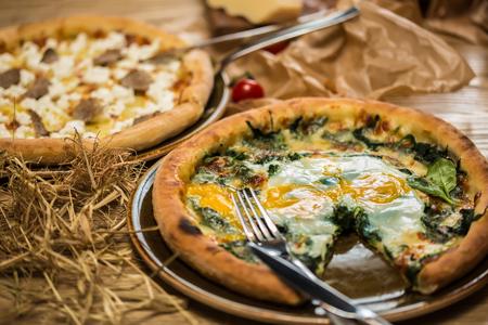 margarita pizza: Margarita pizza with arugula and egg for breakfast, selective focus Stock Photo