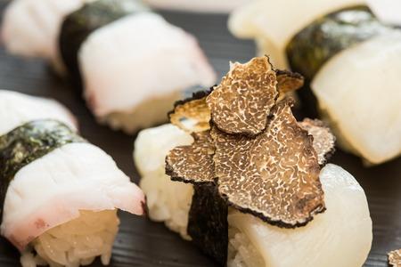Closeup of white tuna nigiri sushi pieces with truffle photo