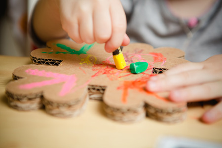 Little female baby painting with colorful paints. selective focus 免版税图像