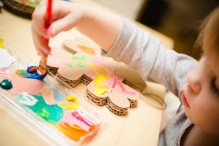 Little female baby painting with colorful paints. selective focus Stockfoto