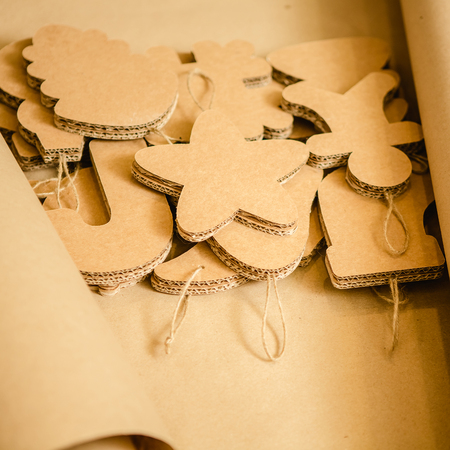 Cardboard toys for the Christmas tree or Christmas garland. Christmas decorations. Selective Focus photo