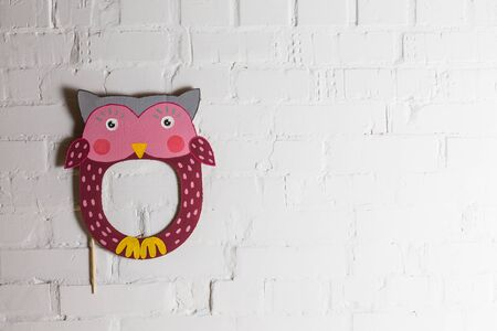 laughable: Bright cardboard mask on a white brick wall. Consept card. Owl Stock Photo