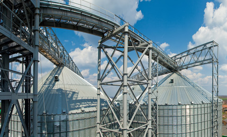 the facility: Towers of grain drying enterprise. metal grain facility with silos