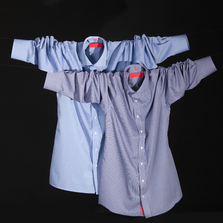 dry cleaned: pair of blue shirt on a black background