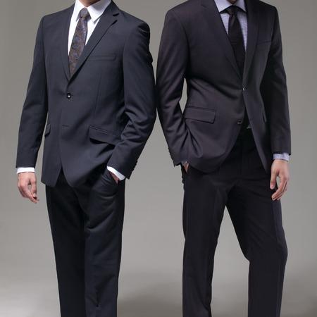 Two men in elegant suit on a dark background Archivio Fotografico