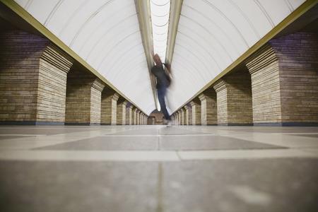 subway platform: Blurred man on subway platform in a big city Stock Photo