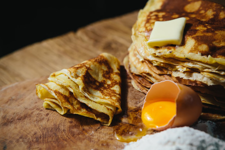 blini: Russian traditional pancakes - blini. On wooden table