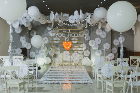 wooden arch and chairs at wedding ceremony