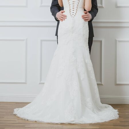 Elegant bride and groom posing together in studio on a wedding day photo