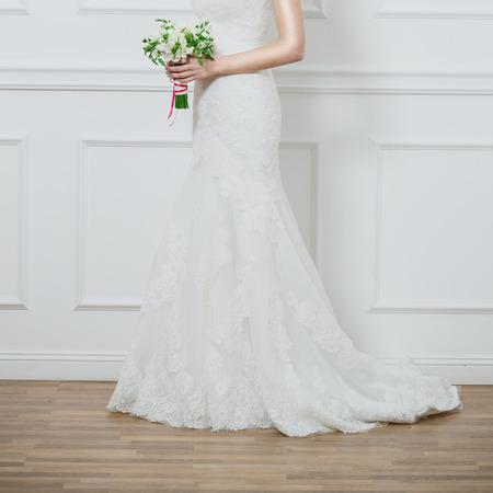 Beautiful wedding bouquet in hands of the bride photo