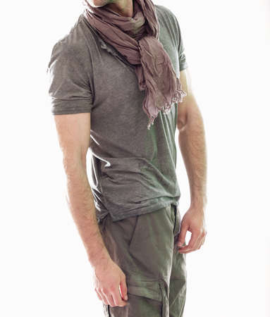 gray clothing: Elegant young handsome man in gray clothing. Studio fashion portrait.